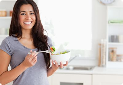 Woman with bowl of health foods